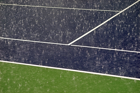 cleaning crew: heavy rain on tennis court the competition must stop