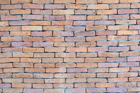 old cracked brick wall as background or texture Stock Photo