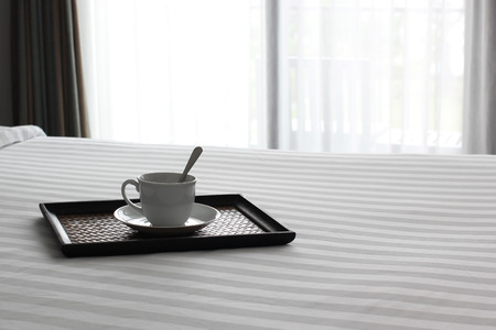 cup of hot coffee on the bed Stock Photo