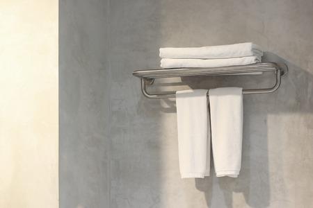 white bath towels on towel rack in bathroom Stock Photo