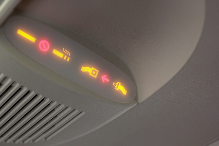 closeup of no smoking and seat belt sign on airplane Stock Photo