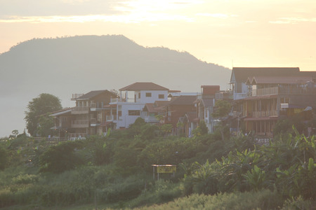 sunrise over the village with mountain background