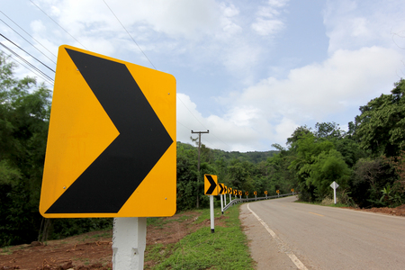 warning curve road sign on countryside road Stock Photo