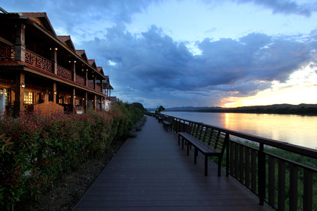 old wooden house along the river with beautiful sky background