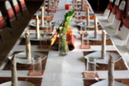 blurry photo of restaurant dinner table setting Stock Photo