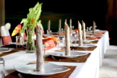 blurry photo of restaurant dinner table setting