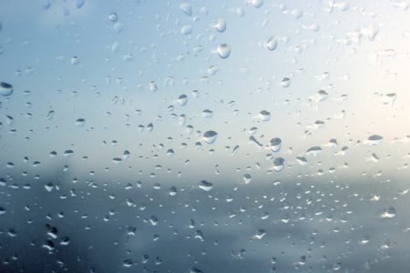 water drops on glass window as background
