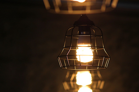 decorative lamp with turn on  light bulb hanging on ceiling