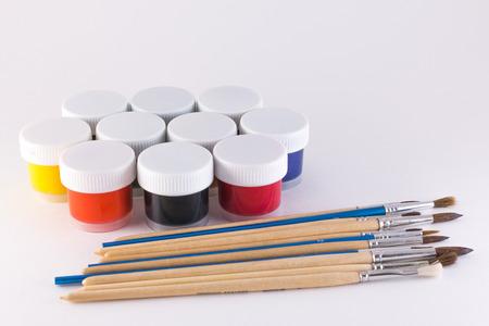 gouache: gouache and brush on a white background Stock Photo