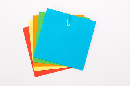 spread sheet: colored sheets with a yellow paper clip Stock Photo