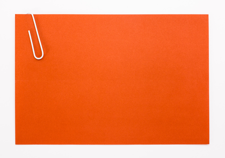 red sheet: red sheet of paper with a white clip