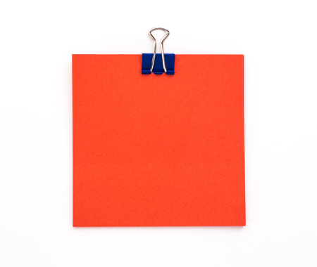 red sheet: red sheet of paper with blue paper clip on a white background