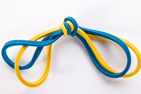 yellow and blue gum rubber bands for money on white background