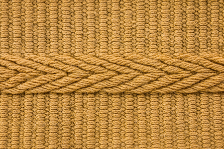 cable knit: yellow knit fabric texture background Stock Photo