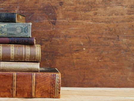 Antique books on a wooden desk. 写真素材