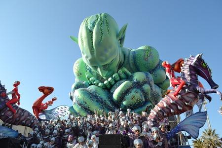 satire: A green monster of a carnival float in Viareggio Carnival 2011