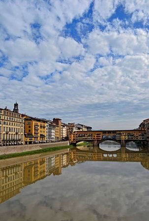 Reflection near Ponte Vecchio old bridge , the famous medieval bridge in the centre of Florence, Italy  photo