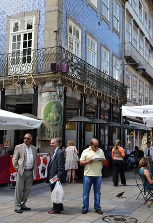 Street life in Portugal, in front of the Brasileira cafè, one of the most important, loved and ancient of the country.