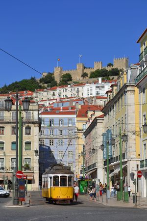 Two of the most representative symbols of Lisbon  Portugal   Sao Jorge castle and the tram n  38  Always crowed by people from Lisbon and tourists  The tram was introduced in the 19th century and were imported from the USA and for this reason called ameri
