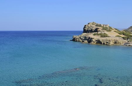 Blue sea and ruins in Crete, Greece  This shot has been taken near Vai beach, and on the headland Itanos a Minoan archaeological site  1500-700 b c    photo