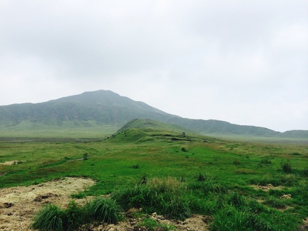 view: Kusasenri plateau with blue sky at Aso mountain.