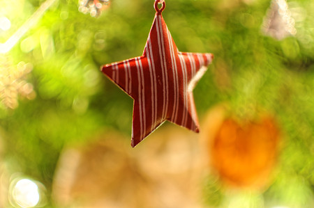 Christmas decoration. Star hanging on xms tree.