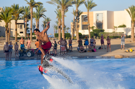 marsa: Marsa ALAM - EGYPT, JULY 21,2014: a Man is flying on a flyboard in the pool in Marsa Alam