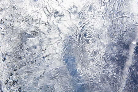 The texture of the ice. The frozen water.Winter background Stock Photo