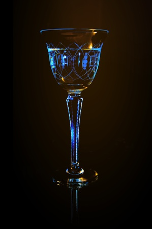 wineglass with white beverage on the black background photo