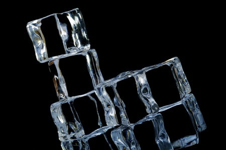 5 ice cube on the black  background with reflection photo