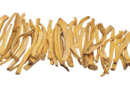 cut dried root isolated on white background photo
