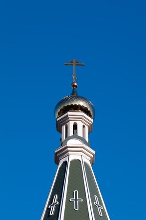 ortodox: ortodox dome cupola with cross on the blue sky background Stock Photo