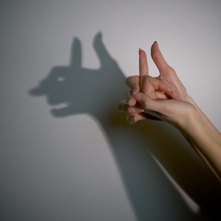 silhouette shadow of devil man from young woman Stock Photo