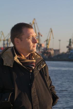 man in the sea port and cranes photo