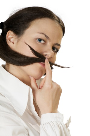 young woman is making a moustache of her hair isolated on the white photo