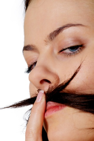 young woman is making a moustache of her hair Stock Photo - 12837492