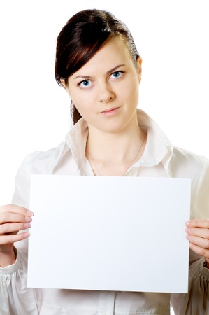 serious girl with a sheet of clean paper in hands isolated on whte background photo