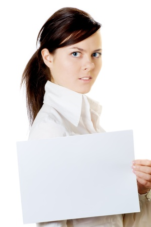 girl with a sheet of clean paper in hand isolated on whte background photo