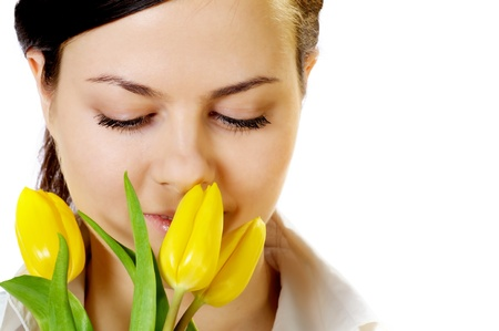 smells: beautiful girl with smile smells yellow tulips