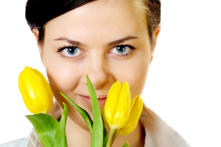 beautiful girl with smile smells yellow tulips photo