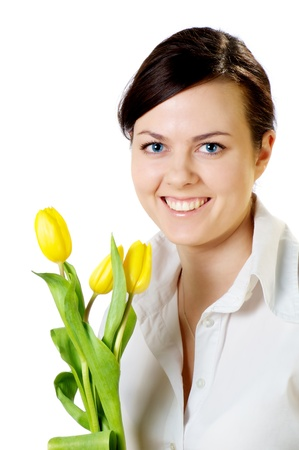smiling girl with yellow tulips bouquet isolated on white photo