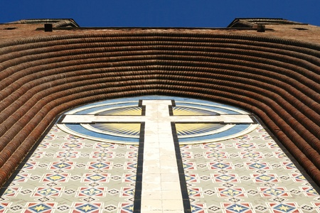 cross on the facade wall of christianity cathedral dome  photo