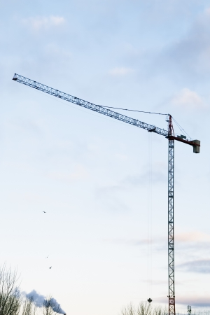 sihouette: Building Crane Sihouette on Morning Sky with Clouds