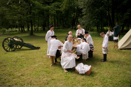reenactment re enactment: people in form arillerymen on celebration of 750 anniversary of Guryevsk (Neuhausen O.P.) on June 30, 2012 in Guryevsk, Kaliningradskaya oblast, Russia