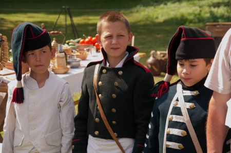 reenactment re enactment: kids in form arillerymen on celebration of 750 anniversary of Guryevsk (Neuhausen O.P.) on June 30, 2012 in Guryevsk, Kaliningradskaya oblast, Russia