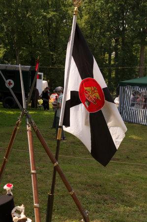 reenactment re enactment: club flag on celebration of 750 anniversary of Guryevsk (Neuhausen O.P.) on June 30, 2012 in Guryevsk, Kaliningradskaya oblast, Russia
