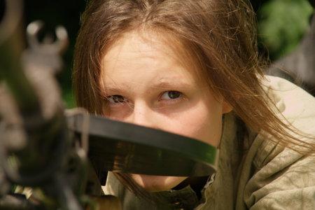 girl with gun on celebration of 750 anniversary of Guryevsk (Neuhausen O.P.) on June 30, 2012 in Guryevsk, Kaliningradskaya oblast, Russia
