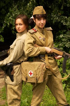 girls with gun on celebration of 750 anniversary of Guryevsk (Neuhausen O.P.) on June 30, 2012 in Guryevsk, Kaliningradskaya oblast, Russia