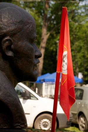 lenin: Lenin bust and red flag Stock Photo