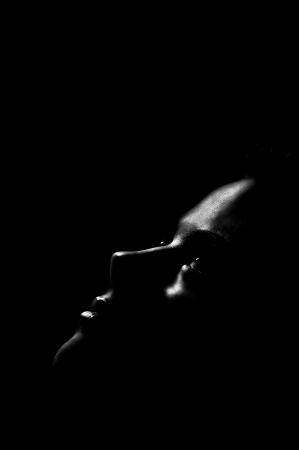 face of girl looking up in dark
